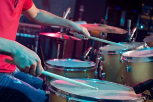 Close-up of playing on drums